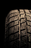 Winter tire isolated on black Stock Photos