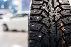 Winter tire in showroom of a car dealer Royalty Free Stock Photo