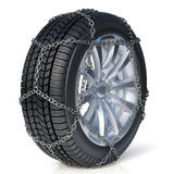 Winter tire with snow chain  on white background Stock Photography