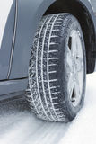 Winter tire in snow, closeup Royalty Free Stock Images