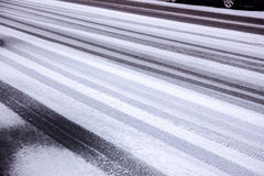 Winter tire tracks on a snowy road royalty free stock images