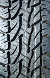 Winter tire tread. Colour markings visible Royalty Free Stock Photo