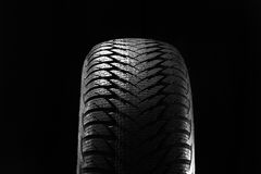 Winter tires isolated on black Royalty Free Stock Photography