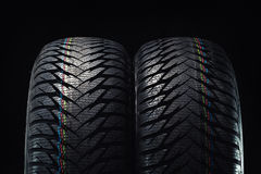 Winter tires isolated on black Royalty Free Stock Images