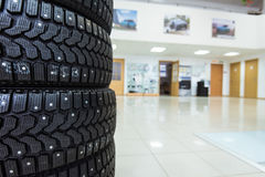Winter tires in showroom of a car dealer Royalty Free Stock Photos