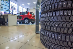 Winter tires in showroom of a car dealer Royalty Free Stock Image