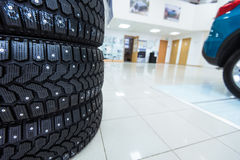 Winter tires in showroom of a car dealer Stock Photography