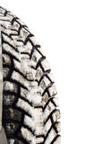 Winter tires in snow. Isolated on a white background Royalty Free Stock Image
