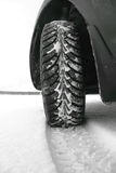 Winter tires in the snow. Close-up Stock Photos