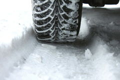 Winter tires in the snow. Close-up Royalty Free Stock Images