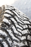 Winter tires in snow Royalty Free Stock Photography