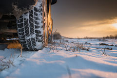 Winter tires in snow Stock Photos