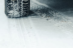 Winter tires in the snow stock photos