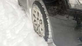 Winter tires on snowy road Royalty Free Stock Photography