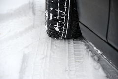 Winter tires on the wheel of a car Stock Photo