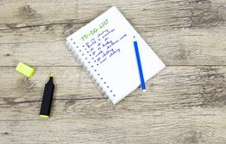Winter to-do lists with markers on wooden backround. royalty free stock photos