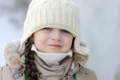 Winter toddler girl in warm  hat Royalty Free Stock Image