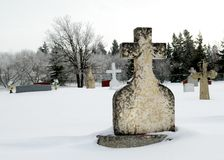 Winter Tombstone. An old tombstone in a winter graveyard Royalty Free Stock Images