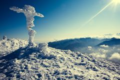 Winter top of the mountain. With a cross Royalty Free Stock Photo