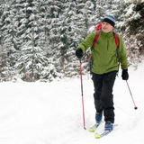 Winter touring. Man on ski touring in snow storm Stock Image