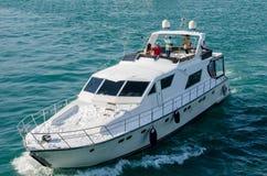 Winter tourisme V. People enjoying a yacht ride in winter season Royalty Free Stock Image