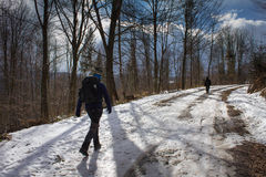 Winter tourists on the trail Royalty Free Stock Image