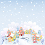 Winter town. Cute winter town on the top of the hill in snowfall. Snowflakes in separate layer