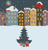 Winter town with christmas tree. Stock Photos