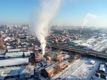 Winter town. Frosty sunny day in the city. Snow on the streets and smoke from the boiler rises. Frost and sun, a wonderful day.  royalty free stock photo