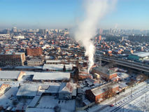 Winter town. Frosty sunny day in the city. Snow on the streets and smoke from the boiler rises. Frost and sun, a wonderful day Royalty Free Stock Images