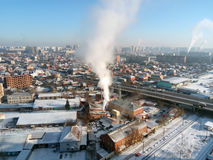 Winter town. Frosty sunny day in the city. Snow on the streets and smoke from the boiler rises. Frost and sun, a wonderful day.  royalty free stock images