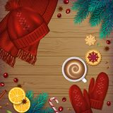 Winter traditional Background. Christmas Elements fir. Branches, knitted red hat, mittens, cup of coffee, cinnamon, cardamom, anise, berries, cookies ribbons on Stock Photo