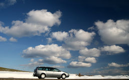 Winter traffic. Traffic  car on a road in the winter with a nice cloudy blue sky Royalty Free Stock Photography
