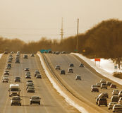 Winter traffic. On the highway at sunset Stock Images