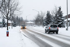 Winter Traffic. Car driving in winter conditions royalty free stock photos