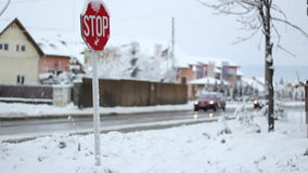 Winter Traffic Sign. Iced STOP traffic sign on a crossroads, on winter time stock video