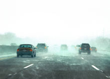 Winter traffic during a snow storm. Picture of traffic on the freeway during a snow storm Stock Photo