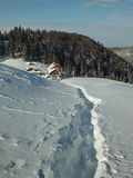 Winter trail leading to the hut. Winter scene on the mountain with trail on thick snow leading to the hut Stock Photo