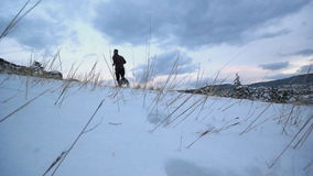 Winter trail running. Through the snow stock footage