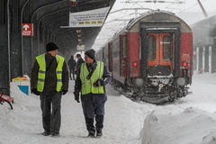 WINTER - TRAIN STATION, delays and trains canceled. Bucharest, Romania, January 29, 2014: Train mechanics are seen in Gara de Nord main railway station, during a Royalty Free Stock Images