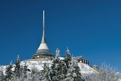 Winter transmission tower. Transmission tower in snow winter county stock photography