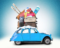 Winter travel. Retro car with Luggage on the roof Royalty Free Stock Photography