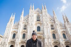 Winter travel, vacations and people concept - Handsome male tourist making selfie photo in front of the famous Duomo. Cathedral in Milan royalty free stock image