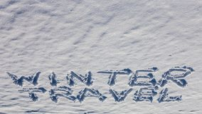 Winter travel words on the snow. Winter travel words handwriting on the flat snow surface Royalty Free Stock Images