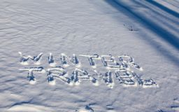 Winter travel words on the snow. Winter travel words handwriting on the flat snow surface Royalty Free Stock Photos