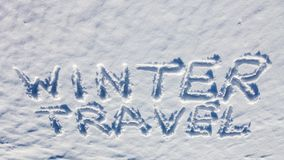 Winter travel words on the snow. Winter travel words handwriting on the flat snow surface Royalty Free Stock Photography