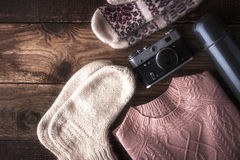 Winter traveler set on the wooden background top view Stock Photos