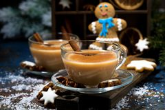 winter treats, masala tea and gingerbread man cookies royalty free stock photography