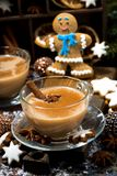 winter treats, spiced masala tea and gingerbread man cookies stock images