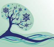 Winter tree. On abstract background with decorative snowflakes Royalty Free Stock Photos